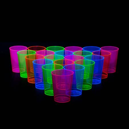 Vasos fiesta neon brillan con luz ultravioleta